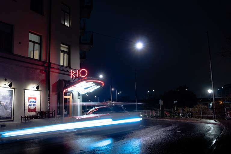 Neon lights outside of Bio Rio retro cinema at night in Stockholm