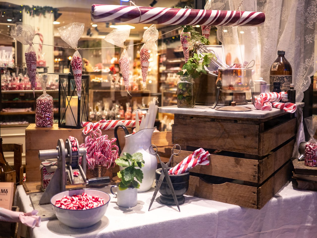 Christmas window display of red and white candy at Gamla stans polkagriskokeri in Stockholm.