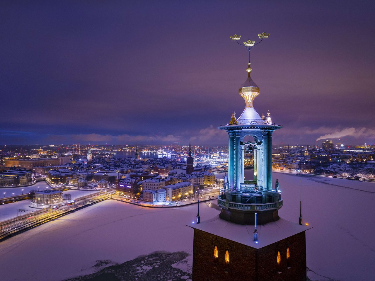 Stockholm covered in snow, with City Hall in the foreground.