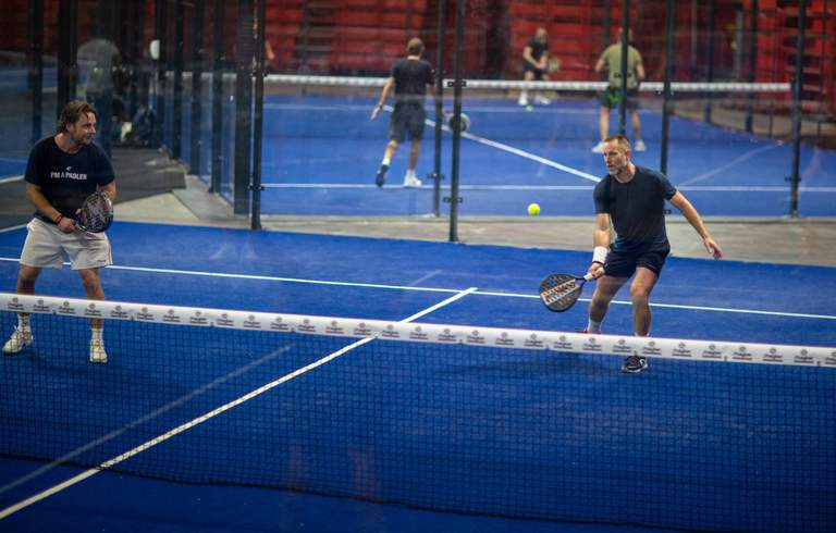 Two men play padel at the Ericsson Globe arena in Stockholm
