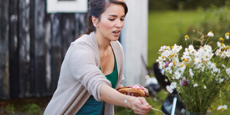 Chef and author Rachel Khoo preparing a meal outdoors. The photo is from her book about Swedish cooking, 'The Little Swedish Kitchen'.