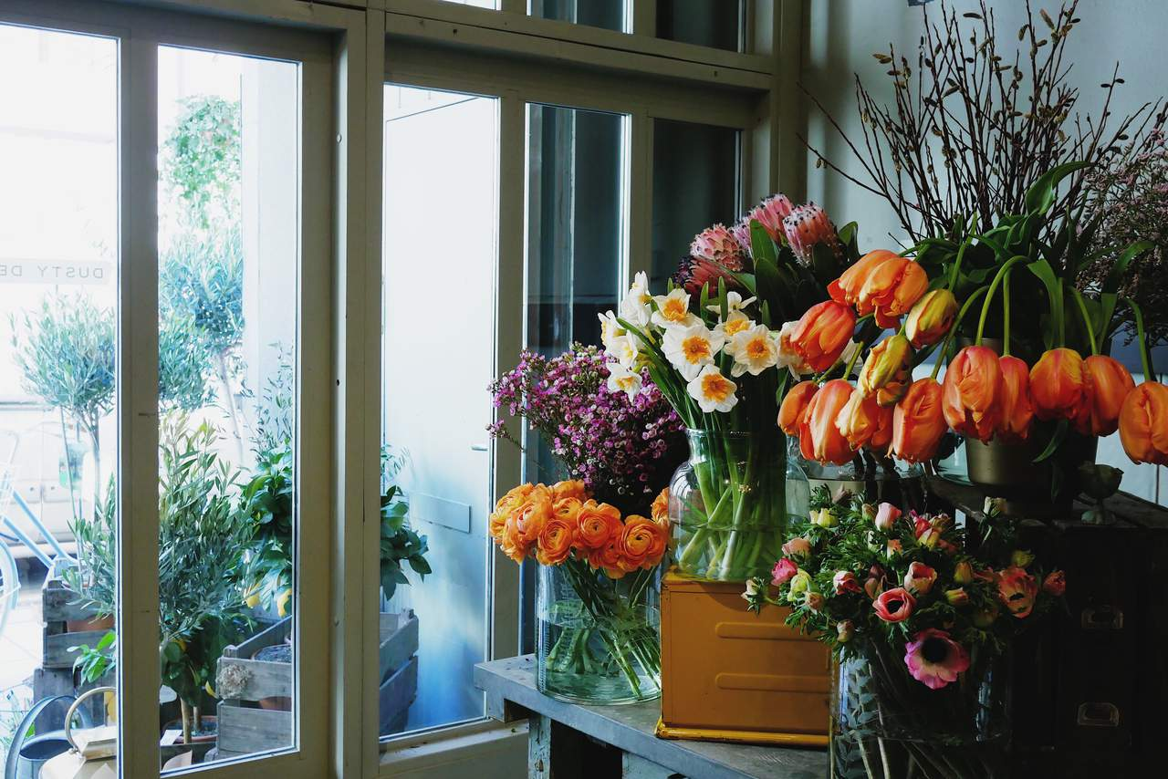 Spring flowers in yellow and orange colors in vases on a table