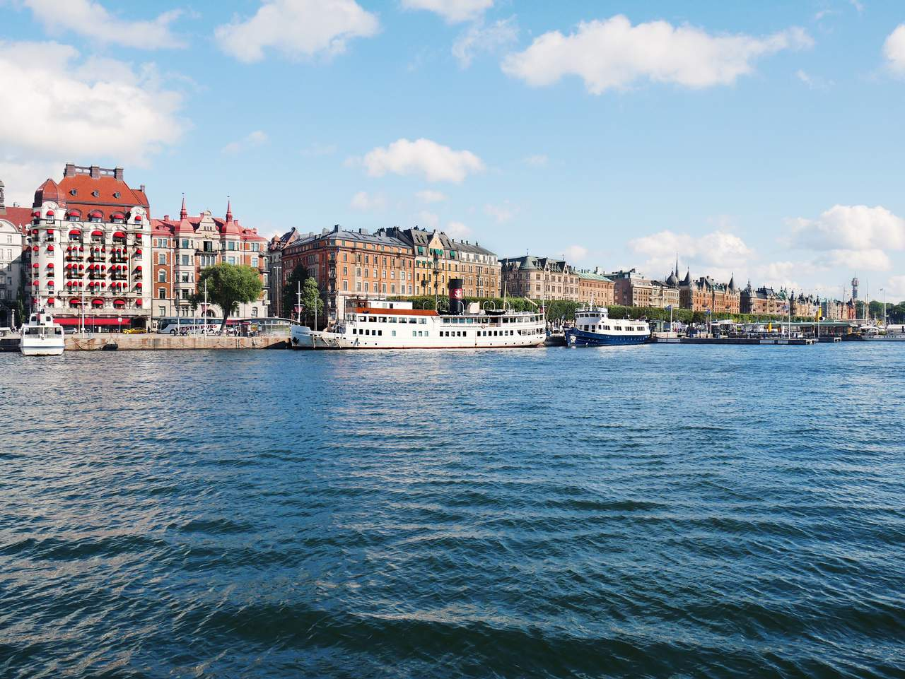 A sunny summer day in central Stockholm. Beautiful old buildings along the water.