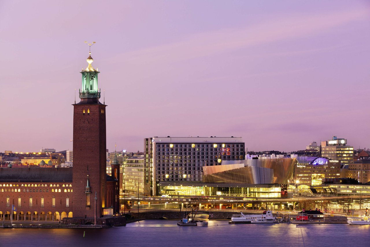 View of Stockholm City Hall and the Waterfront Building at sunset